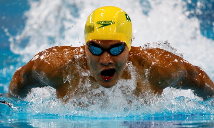 Australia's Kenneth To competes in the men's 100m individual medley heats during the FINA Swimming World Cup 2012 in Dubai, October 2, 2012. (Jumana ElHeloueh/Reuters)