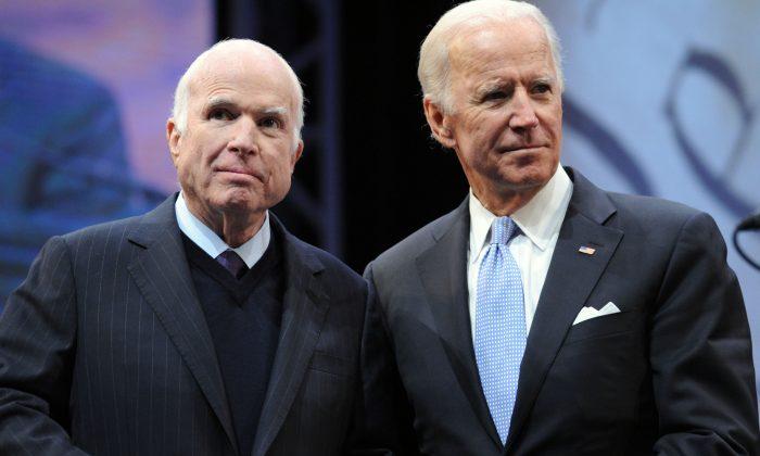Sen. John McCain (R-Ariz.) receives the the 2017 Liberty Medal from former Vice President Joe Biden at the National Constitution Center in Philadelphia, Penn., on Oct. 16, 2017. (William Thomas Cain/Getty Images)