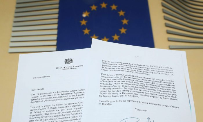 A copy of thelettersent by British Prime Minister Theresa May toEuropean Council President Donald Tusk is seen next to aEuropean Flag on March 20, 2019. (Yves Herman/Illustration/Reuters)