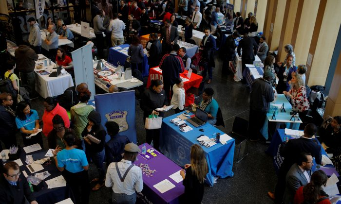 Job seekers speak with potential employers at a City of Boston Neighborhood Career Fair on May Day in Boston, Mass., on May 1, 2017. (Reuters/Brian Snyder)