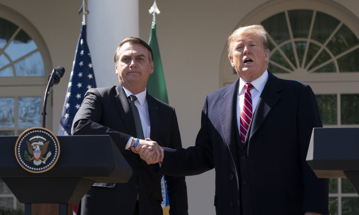 President Donald Trump and Brazilian President Jair Bolsonaro attend a joint news conference in the Rose Garden at the White House on March 19, 2019. (Chris Kleponis-Pool/Getty Images)