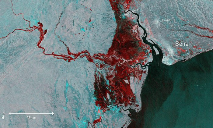 Photo taken from Copernicus Sentinel-1 and provided by the European Space Agency, ESA, shows the extent of flooding, depicted in red, on March 19, 2019. (ESA via AP)
