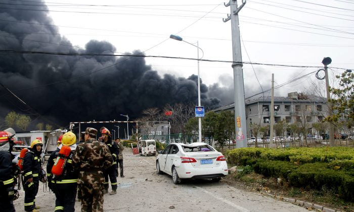 Rescue workers are seen near smoke following an explosion at a chemical industrial park in Yancheng City, China on March 21, 2019. (Reuters)