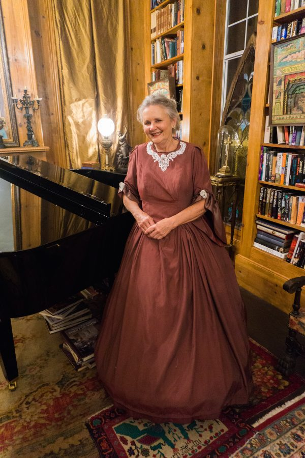 Colleen Wilkins in front of piano at Sunnyside Bed and Breakfast