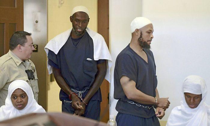 Defendants, from (L), Jany Leveille, Lucas Morton, Siraj Ibn Wahhaj and Subbannah Wahhaj entering district court in Taos, N.M. On Aug. 13, 2018. (Roberto E. Rosales/The Albuquerque Journal via AP)