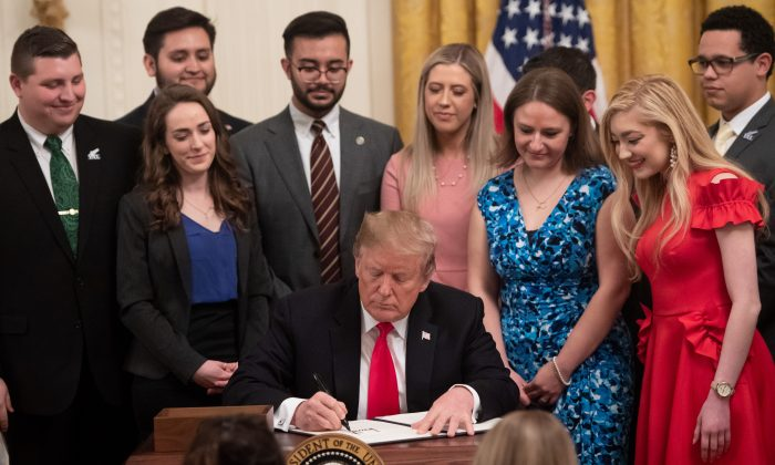 President Donald Trump signs an executive order to protect free speech on college campuses during a ceremony in the East Room of the White House in Washington, on March 21, 2019. (Saul Loeb/AFP/Getty Images)