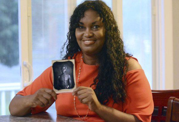 Lanier holds photo of Renty