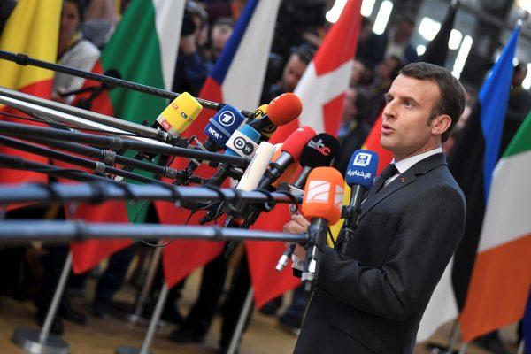 French President Emmanuel Macron talks to the media