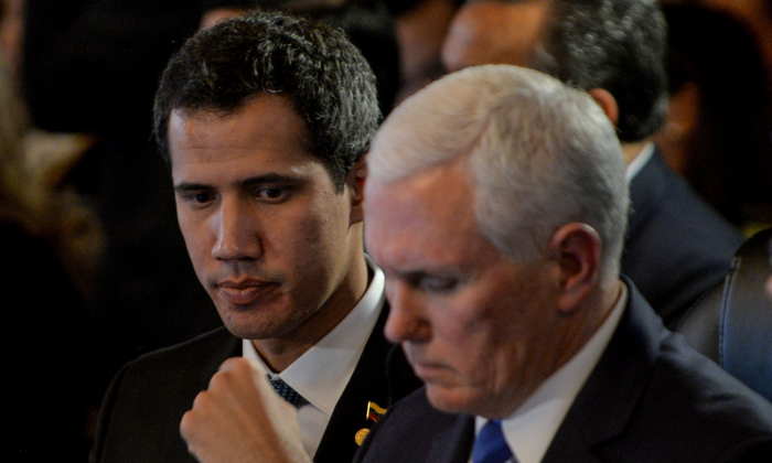 Vice President Mike Pence (R) and Venezuelan Interim President Juan Guaidó, take part in a meeting with Foreign Ministers of the Lima Group at Colombia's Foreign Affairs Ministry in Bogota, on Feb. 25, 2019. (Diana Sanchez/AFP/Getty Images)