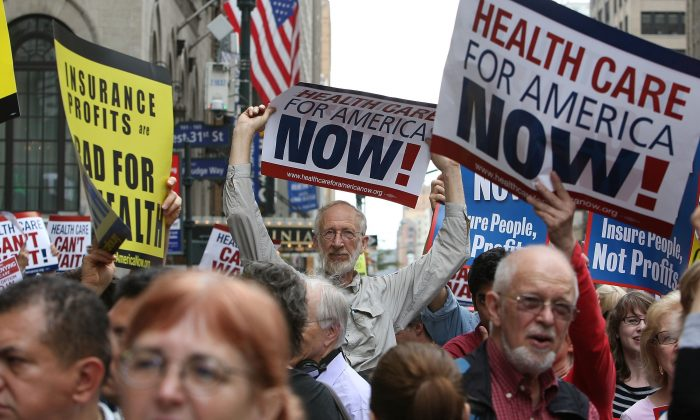"Health care reform supporters protest at a ""Big Insurance: Sick of It"" rally in New York City on Sept. 22, 2009. (Mario Tama/Getty Images)"