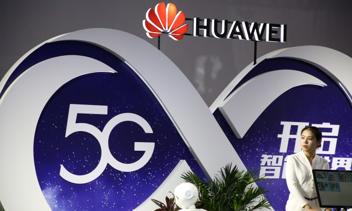 "A woman stands at a Huawei booth featuring 5G technology at the PT Expo in Beijing, China, on Sept. 28, 2018. Former Australian prime minister Malcolm Turnbull recently revealed that Chinese telecom companies Huawei and ZTE were barred from Australia's 5G network as a ""contingency"" should relations sour between the two countries. (Reuters/Stringer)"