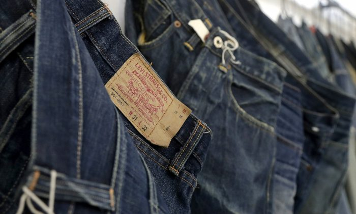 Levi's jeans hanging on a wall at Levi's innovation lab in San Francisco. On Mar. 21, 2019.  (Jeff Chiu, AP Photo/File)