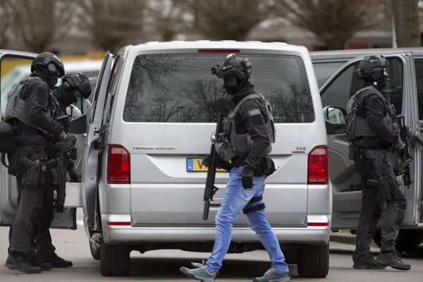 Dutch counter terrorism police prepare to enter a house