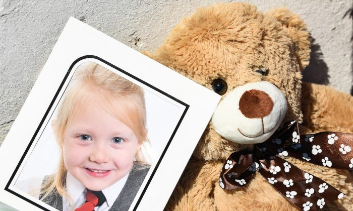A school picture of Alesha MacPhail is left at a house on Ardbeg road on July 4, 2018. (Jeff J Mitchell/Getty Images)