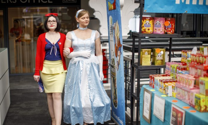 Cosplayers dress as Snow White (L) and Cinderella at the super comic convention in London, United Kingdom, on August 26, 2017. (Tolga Akmen/AFP/Getty Images)