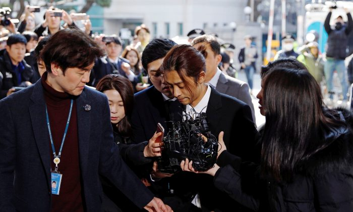 South Korean singer Jung Joon-young arrives for questioning on accusations of illicitly taping and sharing sex videos on social media, at the Seoul Metropolitan Police Agency in Seoul, South Korea, March 14, 2019. (Kim Hong-Ji/Reuters)