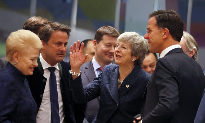 British Prime Minister Theresa May, center, speaks with Dutch Prime Minister Mark Rutte, right, and Lithuanian President Dalia Grybauskaite, left, during a round table meeting at an EU summit in Brussels, on March 21, 2019. (Frank Augstein/AP Photo)