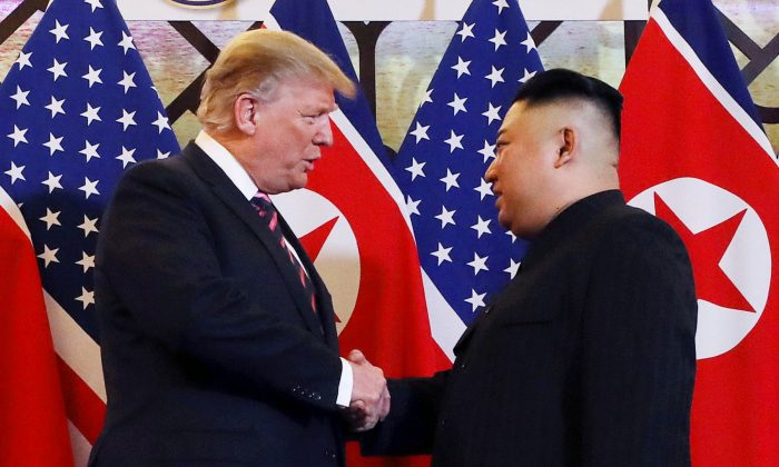 President Donald Trump and North Korean leader Kim Jong Un shake hands before their one-on-one chat during the second U.S.-North Korea summit at the Metropole Hotel in Hanoi, Vietnam on Feb. 27, 2019. (Leah Millis/Reuters)