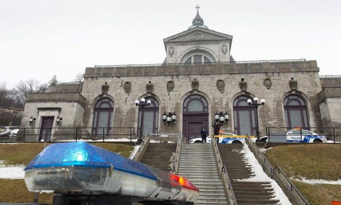 Police cars surround the St. Joesph's Oratory in Montreal, on March 22, 2019. (Paul Chiasson/The Canadian Press)