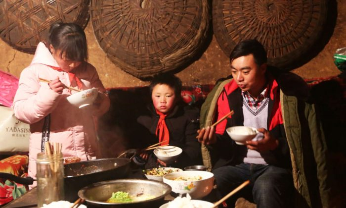 """Wang Fuman, also known as """"Frost Boy"""", with his family in Ludian in China's southwestern Yunnan province on Jan. 11, 2018. (AFP/Getty Images)"""