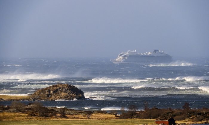 The cruise ship Viking Sky as it drifts after sending a Mayday signal because of engine failure in windy conditions near Hustadvika, off the west coast of Norway, on March 23, 2019. (Odd Roar Lange/NTB scanpix via AP)