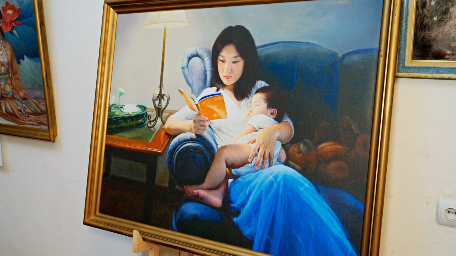 Woman Holding Child and Reading Zhuan Falun..