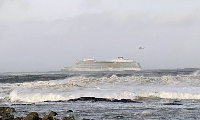 The cruise ship Viking Sky after it sent out a Mayday signal because of engine failure in windy conditions off the west coast of Norway, on March 23, 2019. (Odd Roar Lange / NTB scanpix via AP)