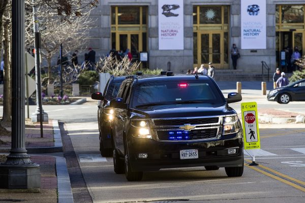 The motorcade for Attorney General William Barr arrives at the Department of Justice