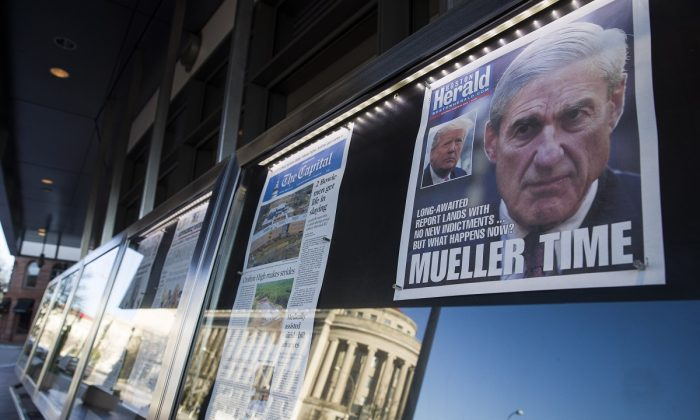 Newspaper front pages from around the nation are on display at the Newseum ,in Washington ,on March 23, 2019.   (Alex Brandon/AP Photo)