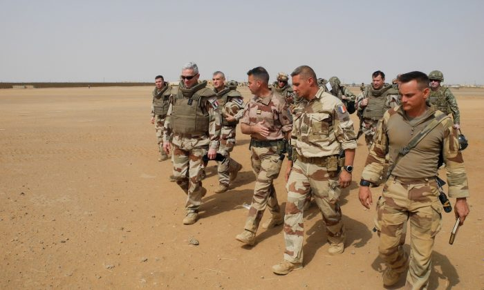 Chief of the General Staff of the French Armies General Francois Lecointre (L), arrives at the base of the Barkhane mission in Africa's Sahel region, in Menaka, Mali on March 21, 2019. (DAPHNE BENOIT/AFP/Getty Images)