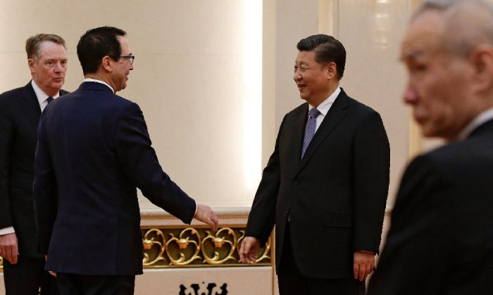 U.S. Treasury Secretary Steven Mnuchin, second from left, talks with Chinese President Xi Jinping as U.S. Trade Representative Robert Lighthizer, left, and Chinese Vice Premier Liu He, right, look on before their meeting at the Great Hall of the People in Beijing, China Feb. 15, 2019. (Andy Wong/Pool via Reuters)