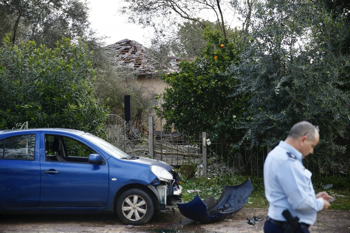 Damage to a house and a car hit by a rocket