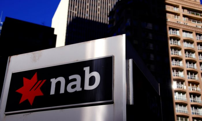 The logo of the National Australia Bank is displayed outside its headquarters building in central Sydney, Australia, on Aug. 4, 2017. (David Gray/File Photo via Reuters)