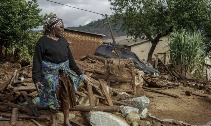 Jessica Mhonderi stands in front of what used to be her son's home in Chimanimani. (KB Mpofu/AP Photo)