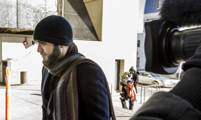Omar Khadr makes his way into the courthouse in Edmonton on Tuesday Feb. 26, 2019.  (The Canadian Press/Jason Franson)