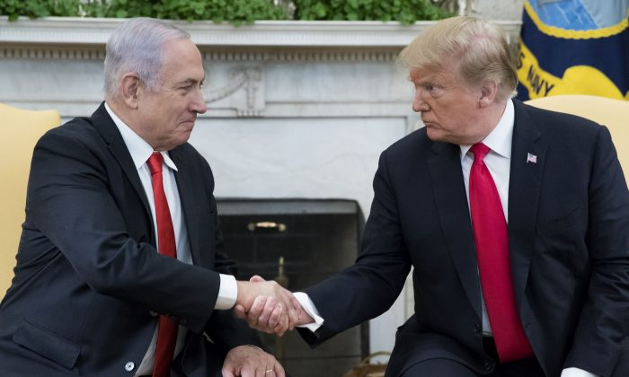 President Trump and Prime Minister of Israel Benjamin Netanyahu shake hands in the Oval Office of the White House on March 25, 2019. (Michael Reynolds - Pool/Getty Images)