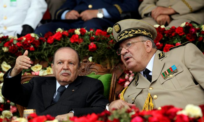 Algeria's President Abdelaziz Bouteflika gestures while talking with Army Chief of Staff General Ahmed Gaed Salah during a graduation ceremony of the 40th class of the trainee army officers at a Military Academy in Cherchell 90 km west of Algiers, Algeria, on June 27, 2012. (Ramzi Boudina/Reuters)