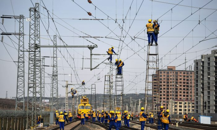 Workers at the construction site of the Tangshan-Hohhot railway in Ulanqab, in north China's Inner Mongolia region, on March 19, 2019. Job growth bounced back in the first quarter as a broad-based, credit-driven rally took shape. (STR/AFP/Getty Images)