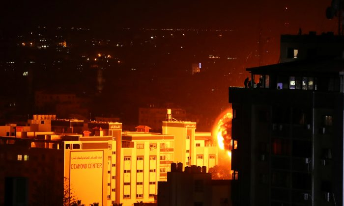 Flame and smoke are seen during an Israeli air strike in Gaza City