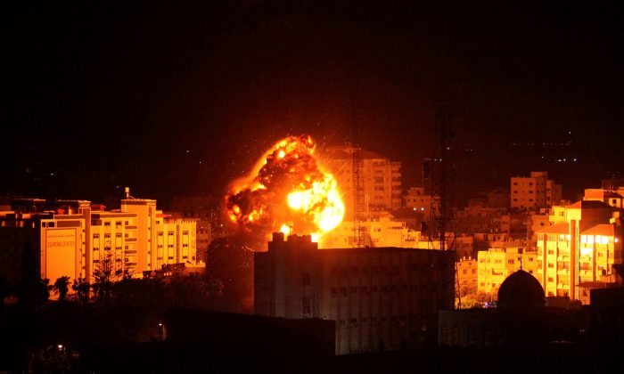 Flame and smoke are seen during an Israeli air strike in Gaza City March 25, 2019. (Mohammed Ajour/Reuters)