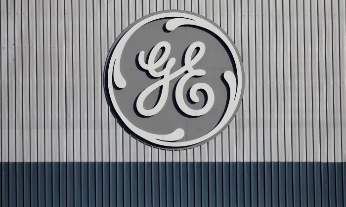 FILE PHOTO: The logo of U.S. conglomerate General Electric is pictured at the company's site of its energy branch in Belfort, France, February 5, 2019. REUTERS/Vincent Kessler/File Photo