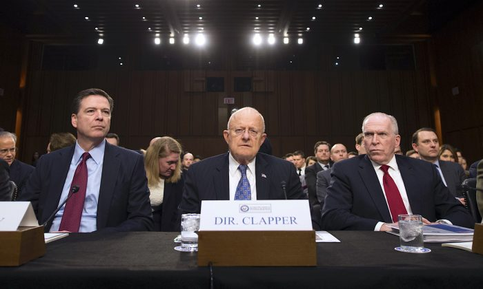(L-R) Then FBI Director James Comey, Director of National Intelligence James Clapper, and CIA Director John Brennan testify before the Senate Intelligence Committee on Feb. 9, 2016. (MOLLY RILEY/AFP/Getty Images)