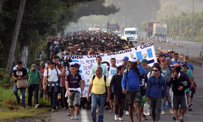 Migrants from Central America and Cuba walk on a highway during their journey towards the United States, in Tuzantan, Chiapas state, Mexico, on March 25, 2019. (Jose Torres/Reuters)