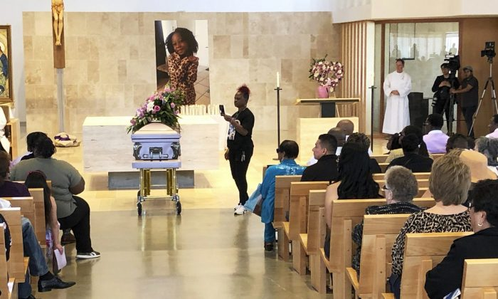 Mourners gather for the funeral service of Trinity Love Jones, the 9-year-old whose body was found this month stuffed in a duffel bag along an equestrian trail, at St. John Vianney Catholic Church in Hacienda Heights, Calif., on March 25, 2019. (John Rogers/AP Photo)