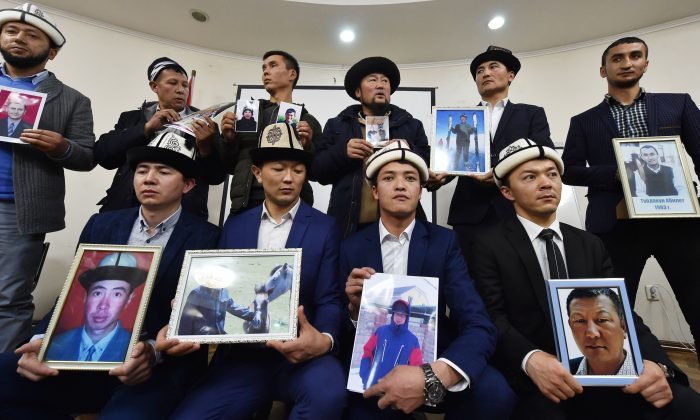 "Kyrgyz men hold portraits of relatives they fear are being held in ""re-education camps"" in China's Xinjiang region, at a press conference in Bishkek, Kyrgyzstan on Nov. 29, 2018.  (VYACHESLAV OSELEDKO/AFP/Getty Images)"