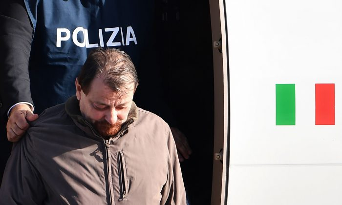 Italian communist militant Cesare Battisti steps off a plane coming from Bolivia in Rome on Jan. 14, 2019. (Alberto Pizzoli/AFP/Getty Images)