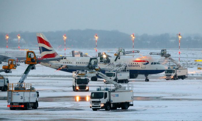 An airplane of British Airways is being de-iced as it stands on the tarmac of the airport in Duesseldorf, western Germany, on Dec. 10, 2017. (David Young/AFP/Getty Images))
