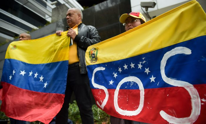 Venezuelans living in Colombia hold a demonstration against a massive blackout that has left millions without power in their country, in front of the U.N. headquarters in Bogota, on March 11, 2019. (Raul Arboleda/AFP/Getty Images)