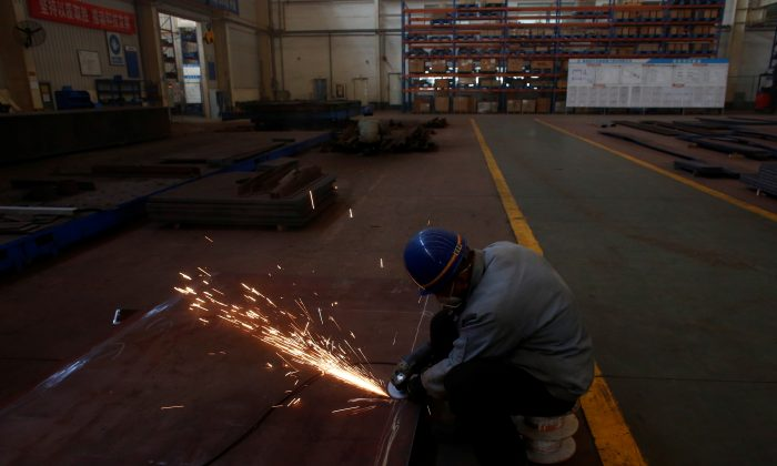 A man works in the Tianye Tolian Heavy Industry Co. factory in Qinhuangdao in the QHD economic development zone, Hebei Province, China on Dec. 2, 2016. (Thomas Peter/Reuters)