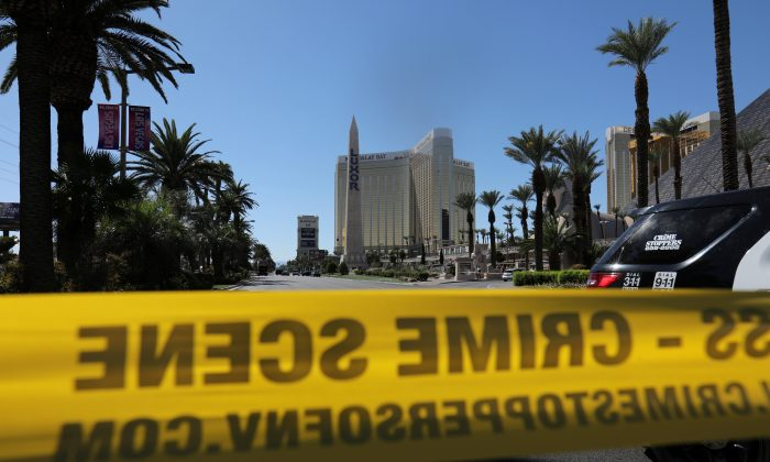 Police crime scene tape marks a perimeter outside the Luxor Las Vegas hotel and the Mandalay Bay Resort and Casino in Las Vegas